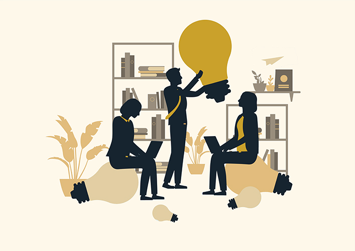 three people having a meeting holding a lightbulb illustration