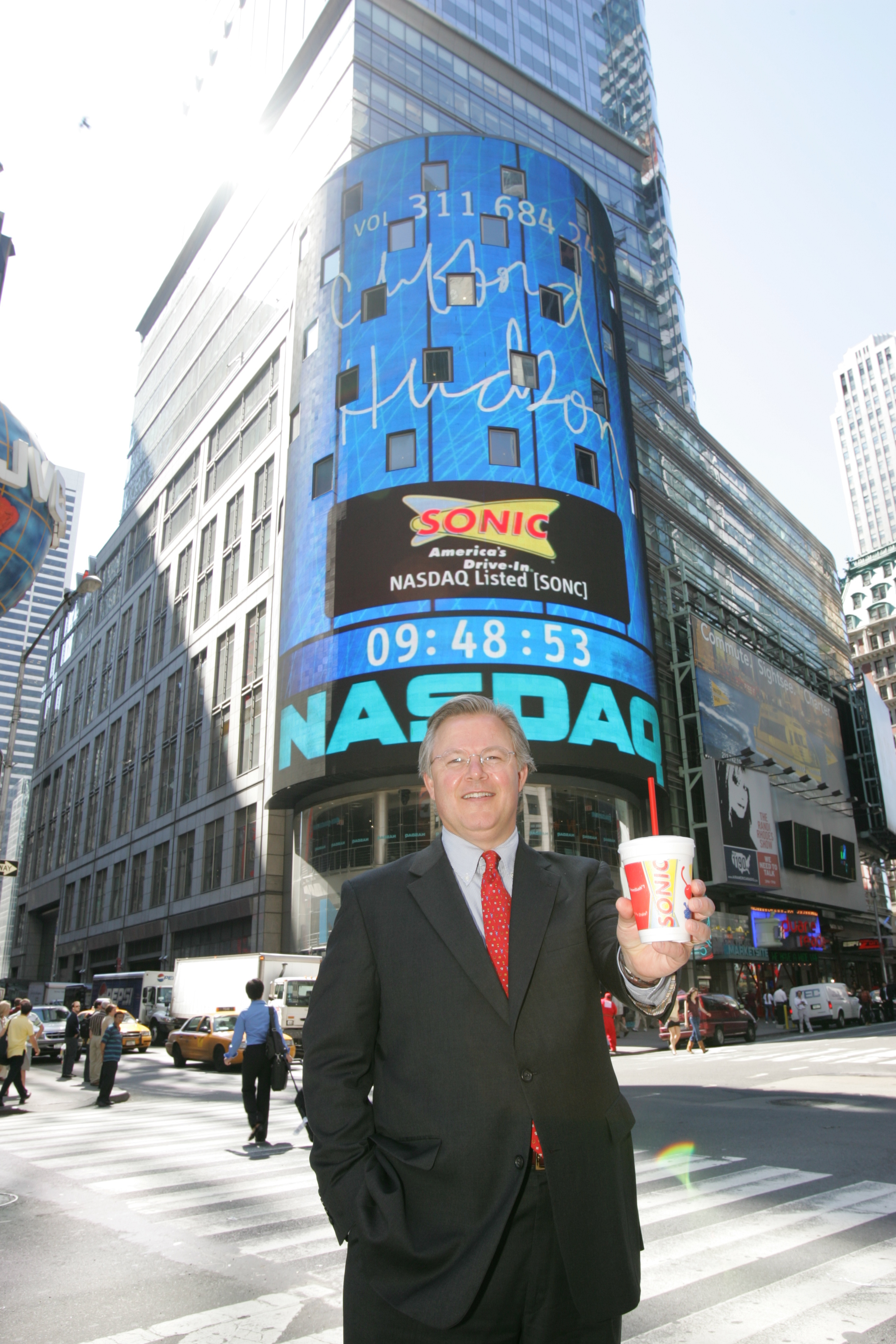 Clifford Hudson in Times Square with Sonic on NASDAQ building